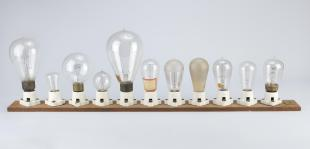 eleven light bulbs on a plank