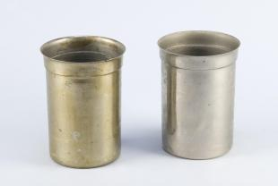 two large nickel beakers