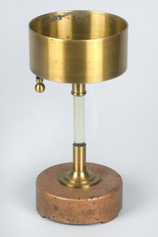 electrified brass cup on insulated stand
