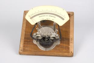 exposed Weston A.C. ammeter on a wooden base