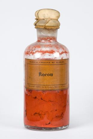 "stoppered glass bottle of ""Rocou"""