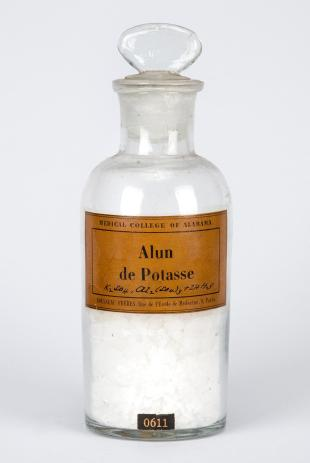 "stoppered glass bottle of ""Alun de Potasse"""