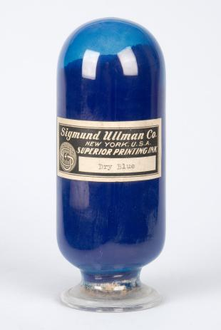 glass bottle of dry blue printing ink