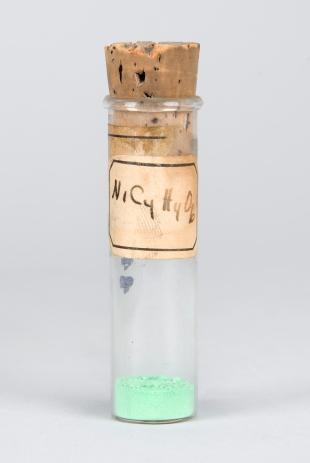 small stoppered test tube of  NiC4H4O6