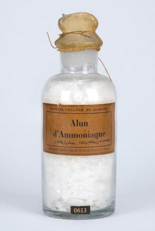 "stoppered glass bottle of ""Alun d'Ammoniaque"""