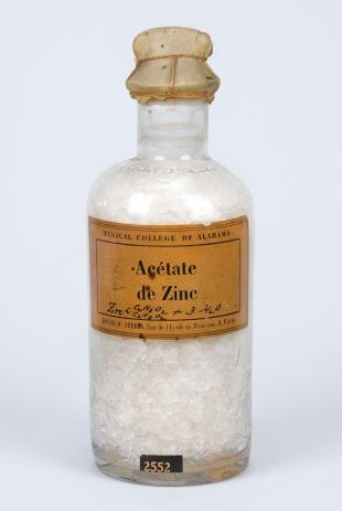 "stoppered glass bottle of ""Acétate de Zinc"""