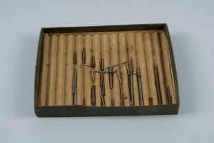 box of magnetized iron rods and nails
