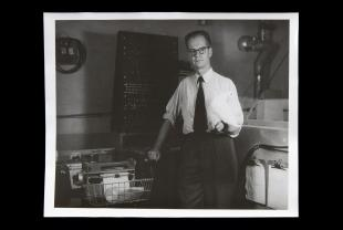 photographs of B. F. Skinner holding a white pigeon in his lab