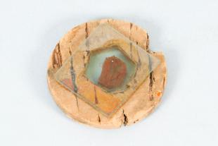 crystal mounted on glass and cork