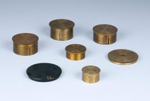 7 miscellaneous dust caps for telescopes and lenses