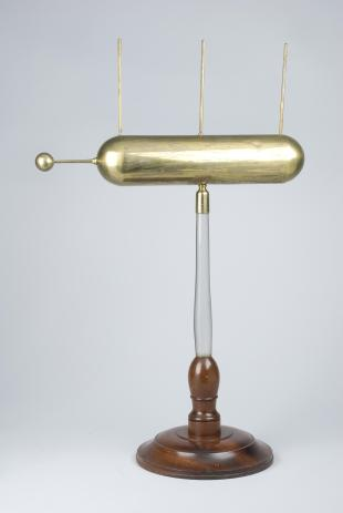 brass electric conductor on glass stand, with ball and three vertical rods