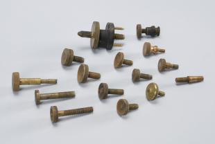 assorted leveling-screw feet and mounting screws