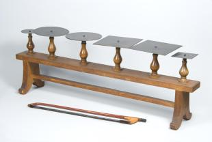 bench with 6 Chladni plates and vioin bow