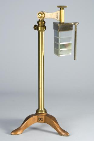 equilateral polyprism on brass stand